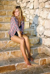 Attractive young woman posing on stone stairs