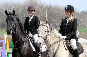teenage girls and tired horses