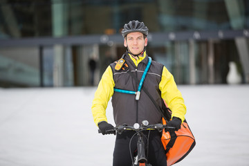 Male Cyclist Carrying Courier Delivery Bag