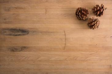 Three Pine Cones on a Countertop