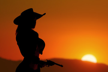 Cowgirl at sunset silhouette