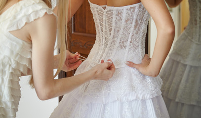 Helping the bride to put her