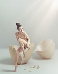 Young beauty in eggshell