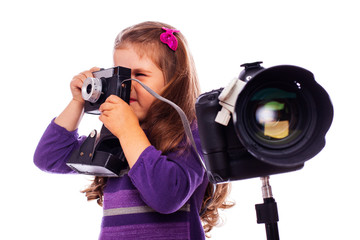 A little girl is taking pictures