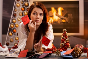 Woman arranging christmas gifts