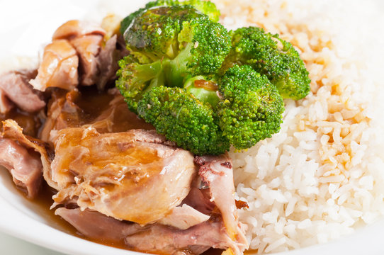 turkey meat with broccoli topped on a rice