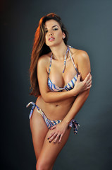 Pretty latin swimsuit fashion model posing in the studio