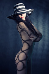 fashion portrait of naked lady with hat