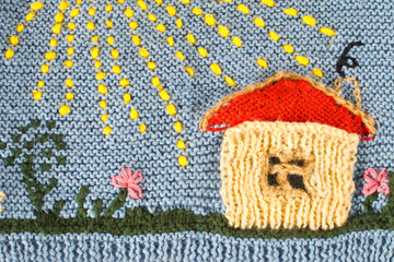Knitted house in the sun