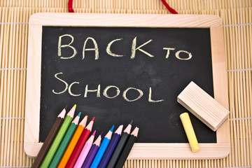 back to school blackboard and pencils