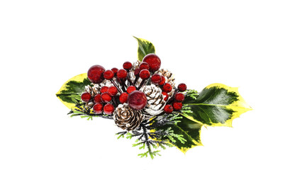 Christmas table decoration of ivy, cones and winter berries