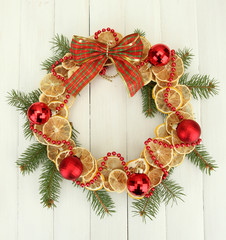 christmas wreath of dried lemons with fir tree and balls,