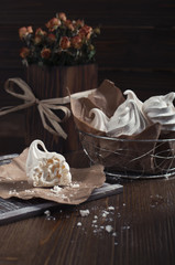 White meringues and dry roses