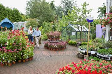 Garden center with couple walking through
