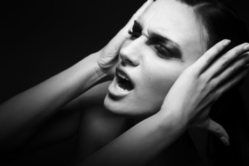 Sad  woman yelling - migraшne. Depression, stress