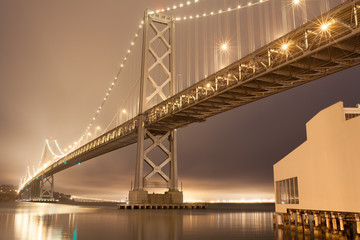 Daybreak with foggy night sky at Bay Bridge , San Francisco