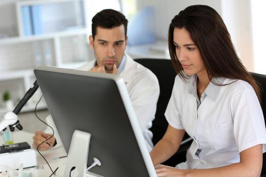 Students working on desktop computer in laboratory
