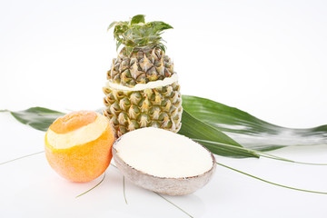Pineapple, coconut, orange on a white background.