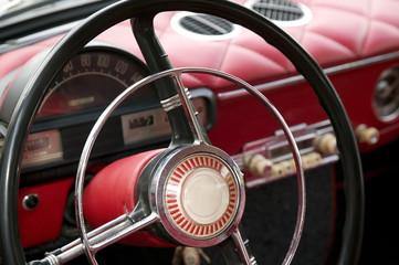Papiers peints Rouge, noir, blanc Antique car with red interior inside
