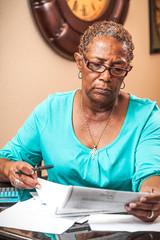 Woman Analyzing Bill