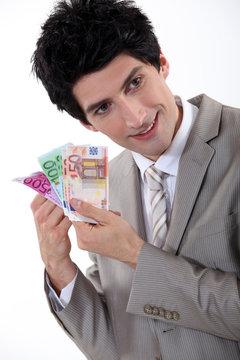 Businessman holding Euro bank notes