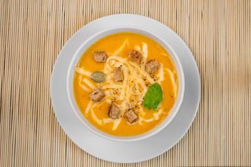 Pumpkin soup in a white plate