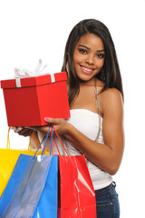 Young African American Woman holding shopping bags and a Gift