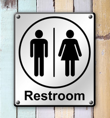 restroom sign on old colour wooden wall