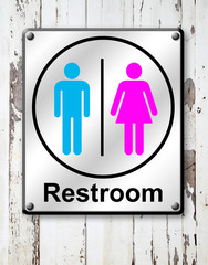 restroom sign on white wooden wall background
