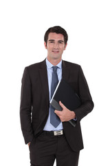 A businessman standing with his folder.