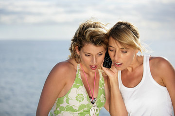 Two shocked women at the beach
