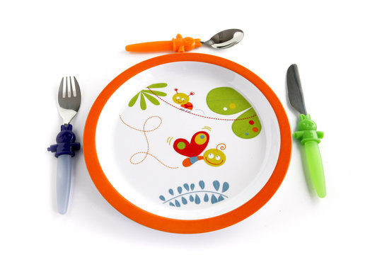 Colorful plate and cutlery for a child