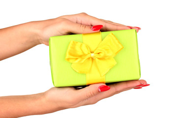 woman holds  box with gift on white background close-up