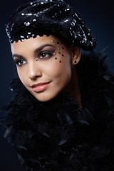 Beauty in party hat and boa