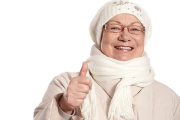 Closeup portrait of elderly woman with thumb up