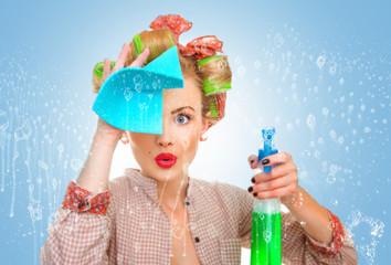 Obraz housewife with rag / wipe and cleaning spray for window - fototapety do salonu