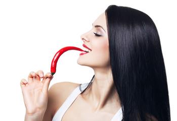 happy woman biting chili pepper