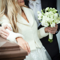 Bride with a posy and groom