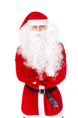Portrait of Santa Claus standing with hands folded against