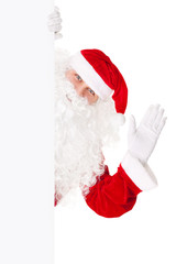 Santa Claus waving with blank sign isolated on white background