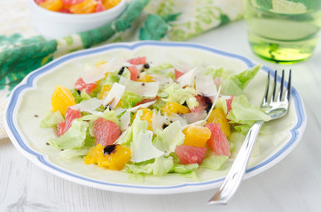 Salad with grapefruit, oranges, iceberg lettuce and cheese
