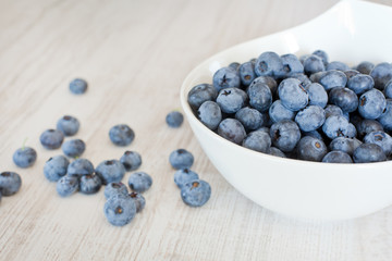 White bowl cup with fresh ripe blueberries