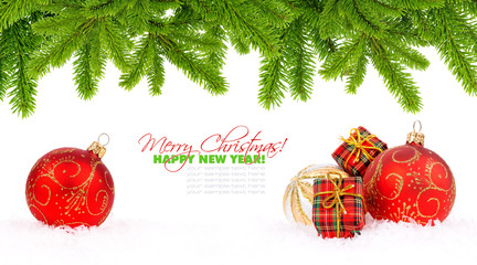 Christmas decoration baubles and pine on white