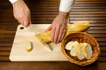 Chef slicing bread, hands detail