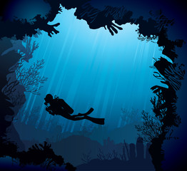 Coral reef with silhouette of diver