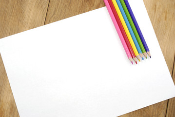 Clear white paper with colorful pencils