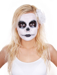young girl in skull makeup for Halloween isolated