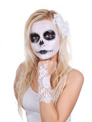 skull makeup on young girl with white roses and lace gloves