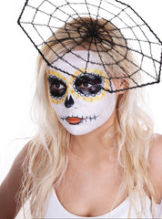 skull makeup on young girl with cobweb on her head isolated