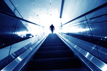 man on the escalator, modern interior..